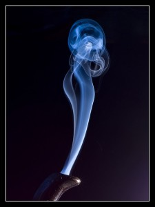 Smoke curls up