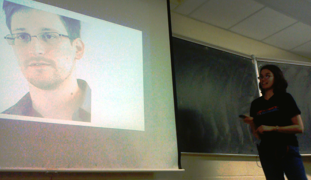 Sarah Harvey shows a slide of Edward Snowden