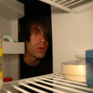Face peeking into fridge
